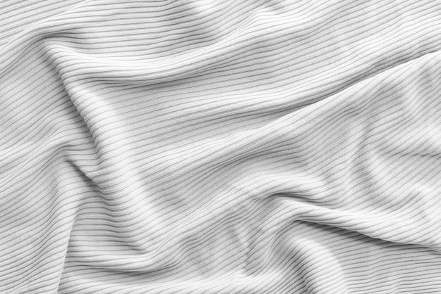 Abstract background from corrugated white fabric.