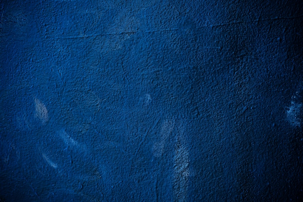 Abstract background from dark blue color painted on concrete texture wall. retro and vintage backdrop.