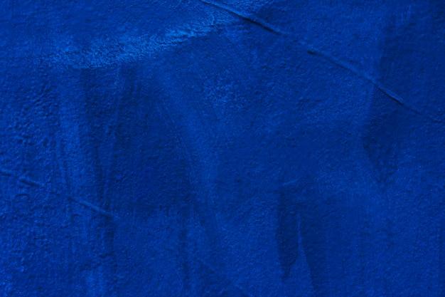 濃い青のコンクリートテクスチャ壁から抽象的な背景。ヴィンテージとレトロな背景。