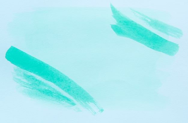 Abstract background from light green color painted on white paper.