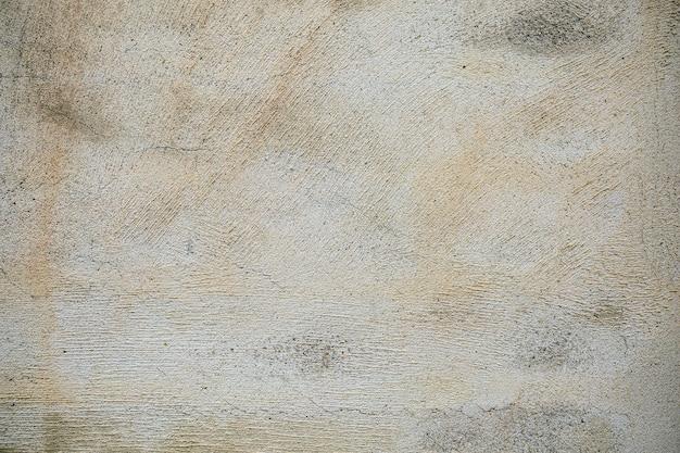 グランジと傷のあるヴィンテージの背景を持つ古い灰色のコンクリートのテクスチャから抽象的な背景