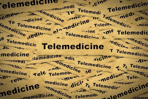 ビネットに遠隔医療と関連する単語が刻まれた紙片からの抽象的な背景。
