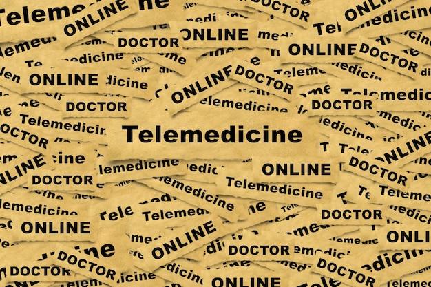 碑文の遠隔医療と関連する単語と紙片からの抽象的な背景。