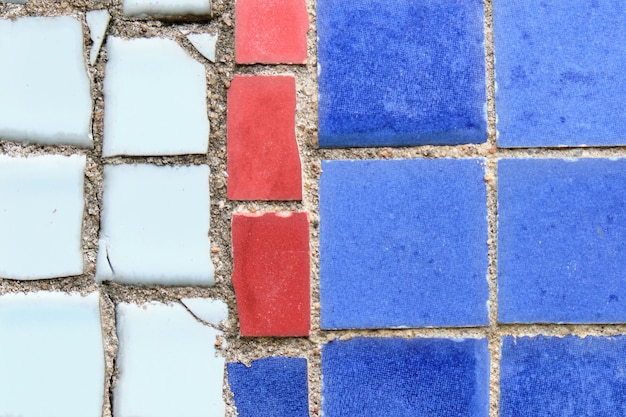 Abstract background from pieces of tiles in a mosaic