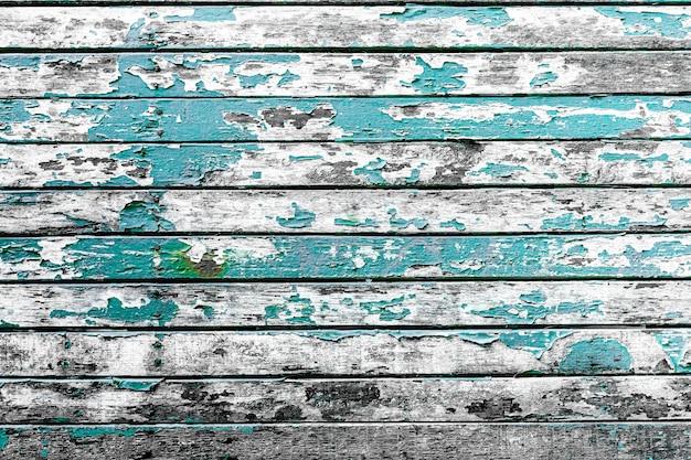 グランジと古い青い木製テーブルのテクスチャから抽象的な背景と傷。素材表面の色むき。ヴィンテージとレトロな背景。