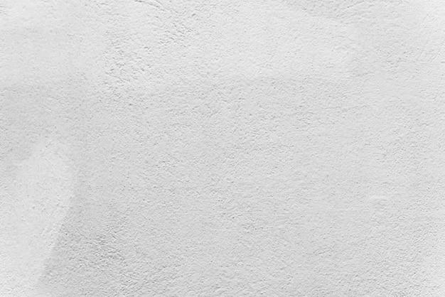 白いコンクリートの壁からの抽象的な背景。白は壁紙を描いた。