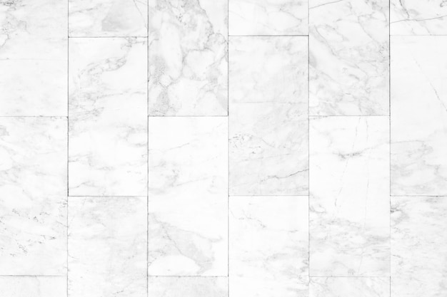 Abstract background from white marble pattern wall with sunlight.