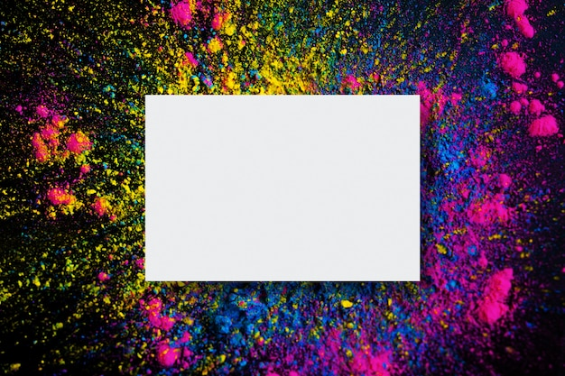 Abstract background of holi color explosion with empty frame