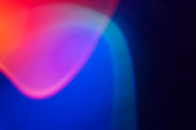 ネオングラデーションの抽象的な背景。鮮やかなブルー、ピンク、オレンジの色