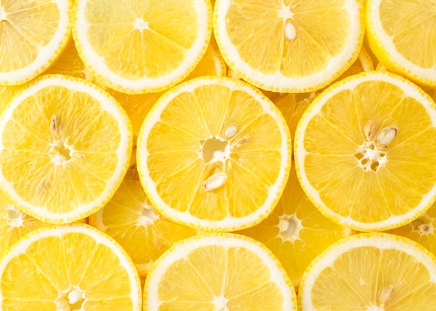Abstract background of lemon slices top view. close up