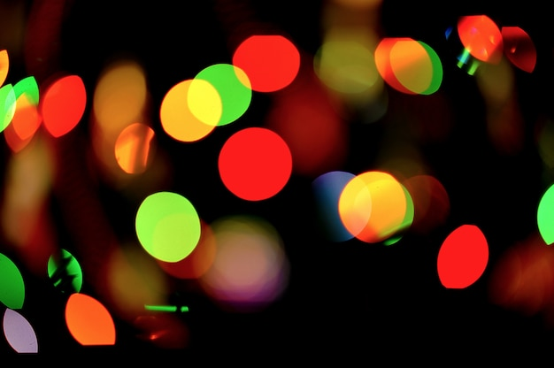 Abstract background of lights on toys on the christmas tree