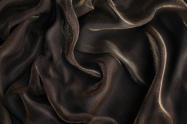 Абстрактный фон роскошная ткань или жидкая волна или волнистые складки гранжевой текстуры или роскошный рождественский фон или элегантный дизайн обоев, фон