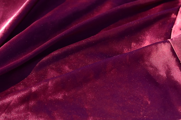 Ткань абстрактного фона роскошная или жидкая волна или волнистые складки