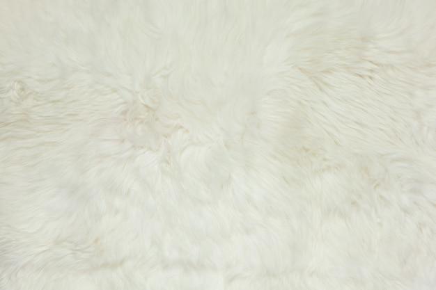 Абстрактный фон, молочно-белый меховой ковер из овчины, копия пространства