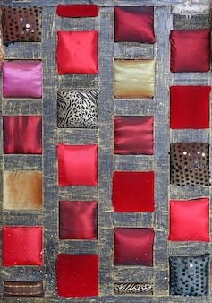 Abstract background of multi color fabric on wooden