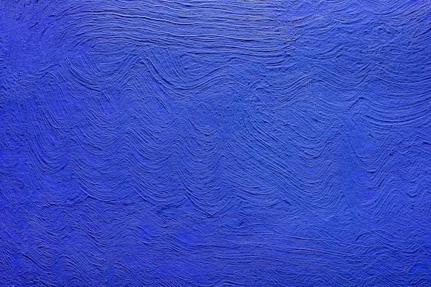 아크릴 물감에서 파란색의 추상적인 배경입니다. 콘크리트 배경입니다.