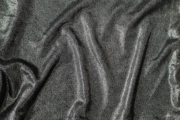 Абстрактный фон из яркой блестящей серебристой ткани