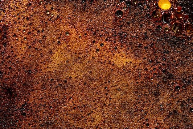 茶色の溶けたキャラメルの抽象的な背景。大きい。上面図、フラットレイ。コピースペース