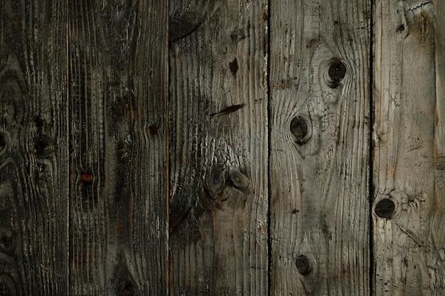焦げた木の板の抽象的な背景クローズアップアートワークの高品質の写真のトップビュー