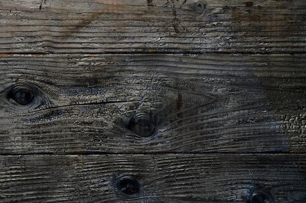 焦げた木の板の抽象的な背景。アートワークのクローズアップトップビュー。高品質の写真