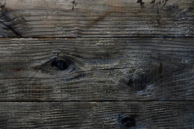 アートワークの焦げた木の板のクローズアップのトップビューの抽象的な背景