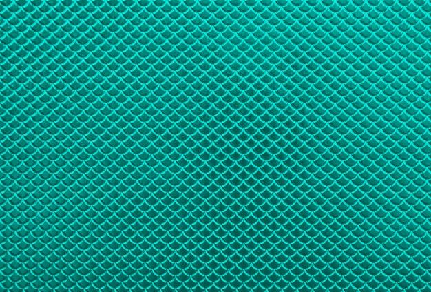 光沢のある光沢のあるメタリックビビッドターコイズティールスケール形状パターンの抽象的な背景