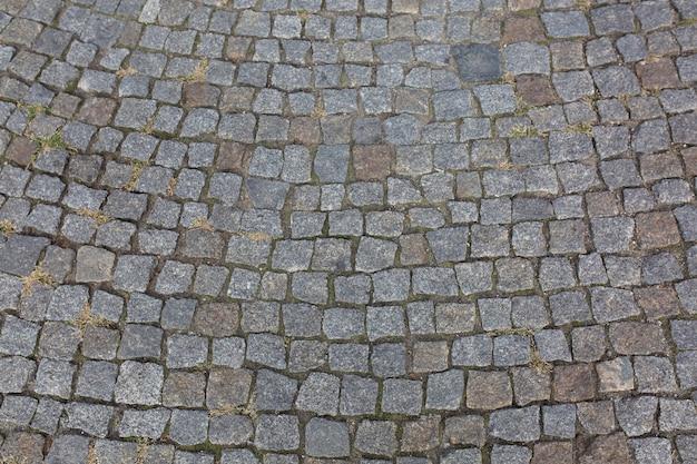 체코 프라하에 있는 오래된 조약돌 포장의 추상적 배경. 근접 촬영