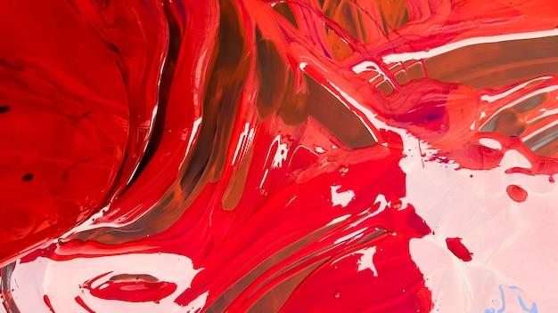 黒の背景にバケツとこぼれた赤いペンキの抽象的な背景。黒の背景に赤い絵の具が注がれています。アーティストやクリエイティブなコンセプトに使用してください。こぼれた赤い色の背景をペイントします。