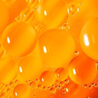 Абстрактный фон из капель масла на воде.