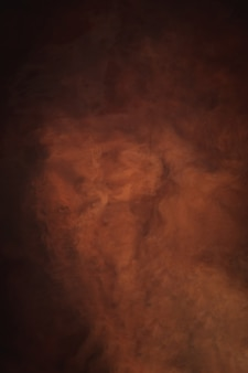 Abstract background, red, orange and brown nebula color, creative liquid texture, dark and light, red river water and dust floating in water