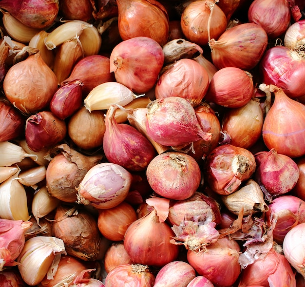 Abstract background of red shallots in the basket. shallots is thai herb. top view of red shallots.