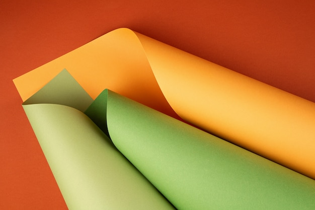 Abstract background of rolled textured paper sheets of different shades