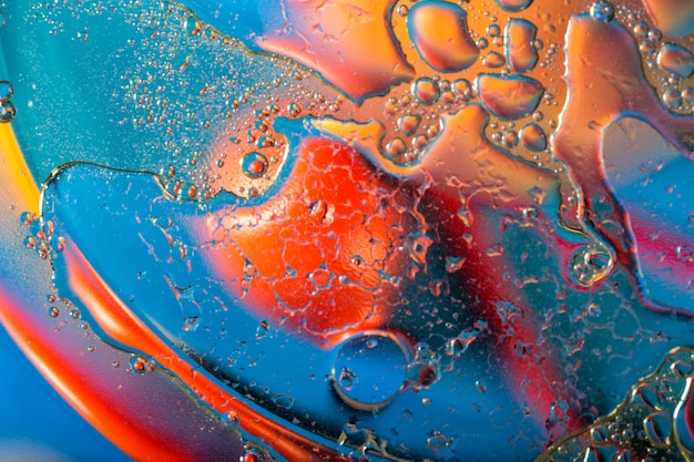 Abstract background in saturated colors with oily drops