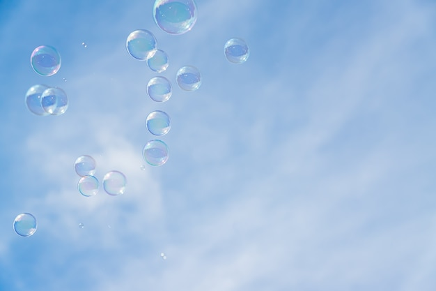 Abstract background, soap bubbles on blue sky