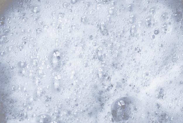 Абстрактный фон мыльной белой пены и пузырей