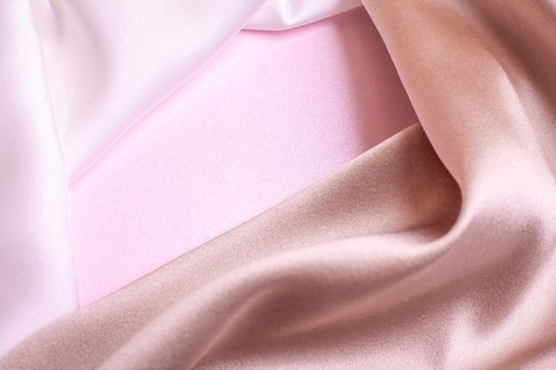 Abstract background in soft colors of silk fabrics on pink pearl paper. beautiful trend texture.