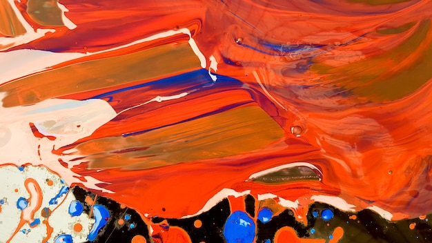 Abstract background of spilled red paint with buckets on a black backdrop. red paint is pouring on a black background. use it for an artist or creative concept. paints spilled red colored background.