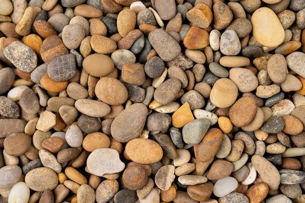 추상적 인 배경 질감 다채로운 바다 돌 배경 회색과 베이지 색 혼합 색상 강 조약돌