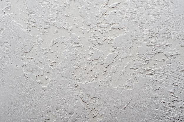 抽象的な背景テクスチャ。装飾的な粗い不均一な漆喰またはコンクリートの壁