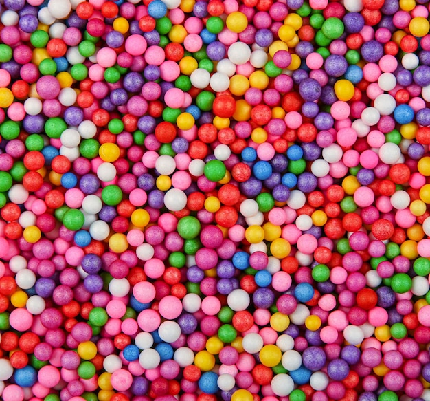 Abstract background texture of multicolor expanded polystyrene balls, close up