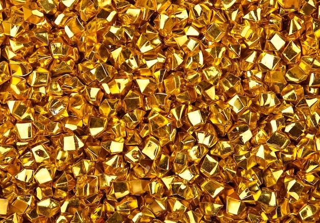 다채로운 밝은 황금 덩어리의 추상 배경 질감