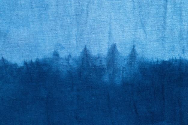 Абстрактный фон tie dye swirl design яркий синий родной стиль, вид сверху