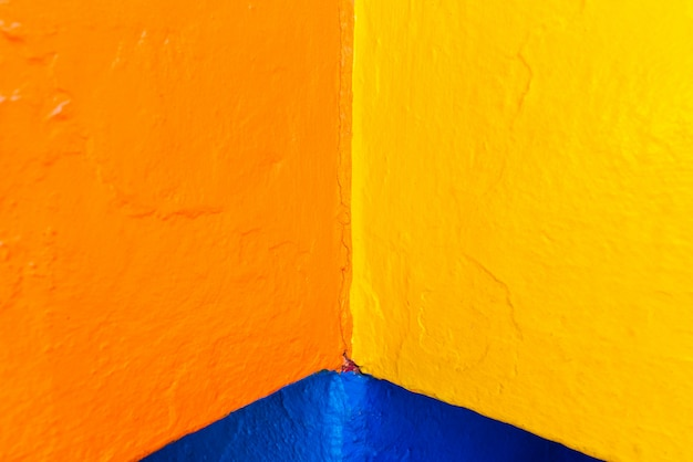 Abstract background of variable geometry and intense yellow and blue colors.
