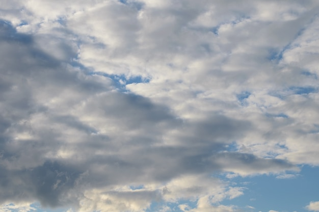 Abstract background of white fluffy clouds on a bright blue sky high quality photo