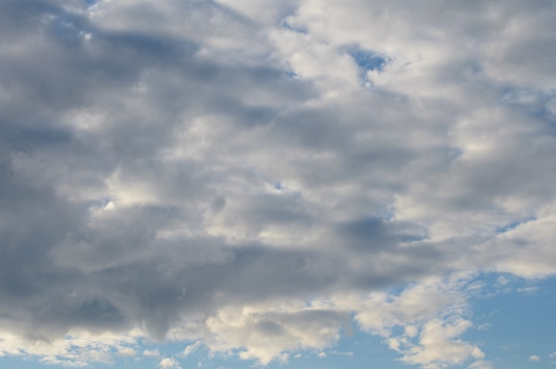 Abstract background of white fluffy clouds on a bright blue sky. high quality photo