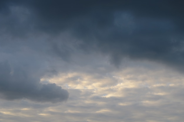 Abstract background of white fluffy clouds on a bright blue sky.