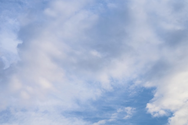 Abstract background of white fluffy clouds on a bright blue sky