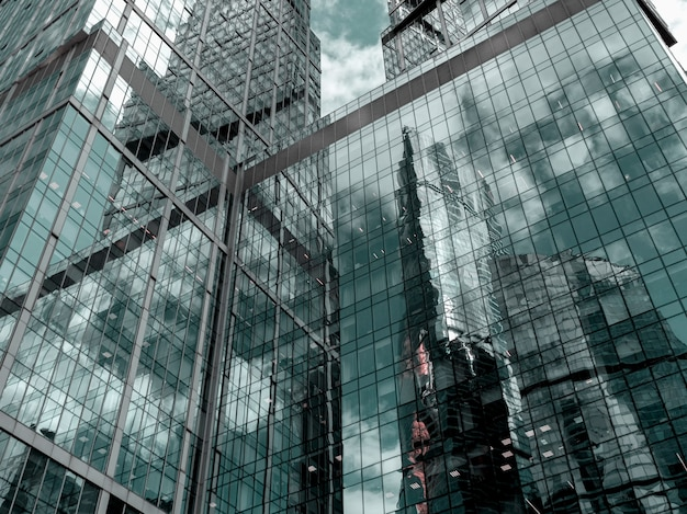 Abstract background with blurred reflections in mirrors. abstract fragment of modern architecture, walls made of glass.