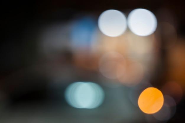 ボケ味の焦点がぼけたライトと抽象的な背景
