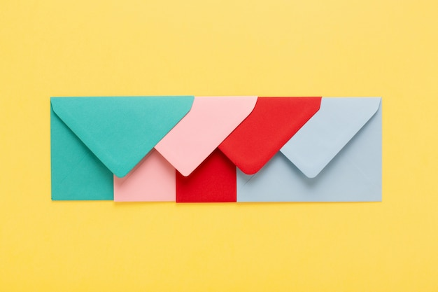 Abstract background with colorful envelopes on yellow